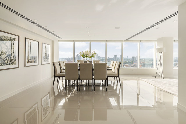 Inspiration For A Huge Contemporary Porcelain Floor Dining Room Remodel In  London With Beige Walls