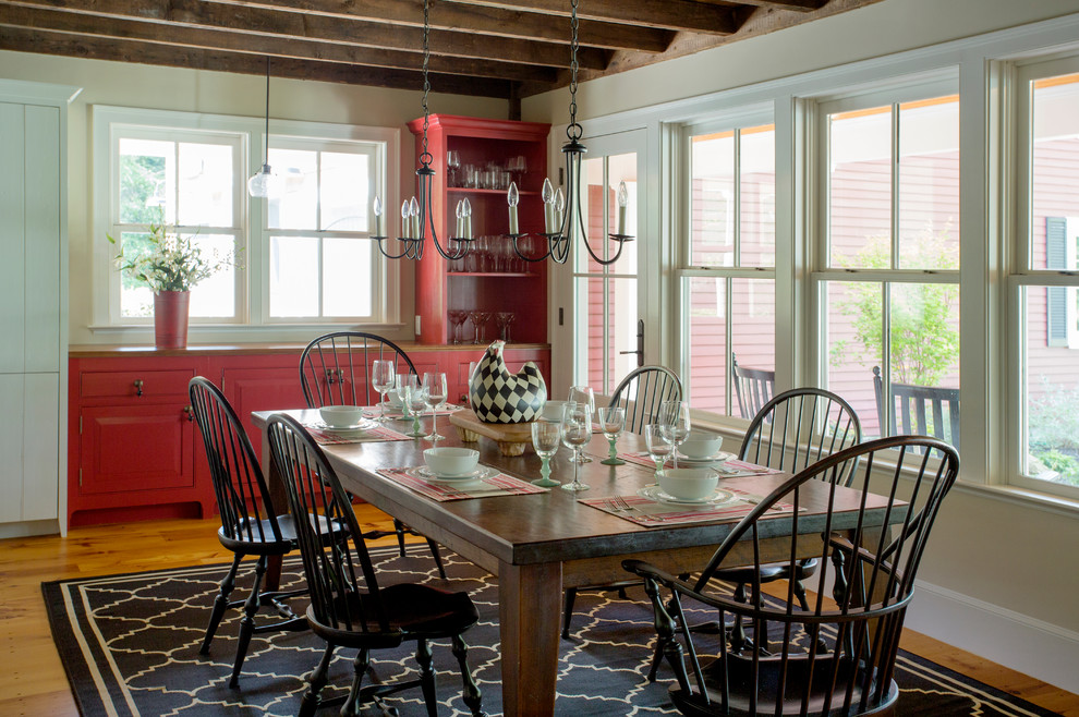 Inspiration for a mid-sized farmhouse medium tone wood floor dining room remodel in Boston with beige walls