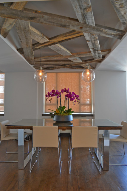 Trendy dark wood floor dining room photo in New York with white walls