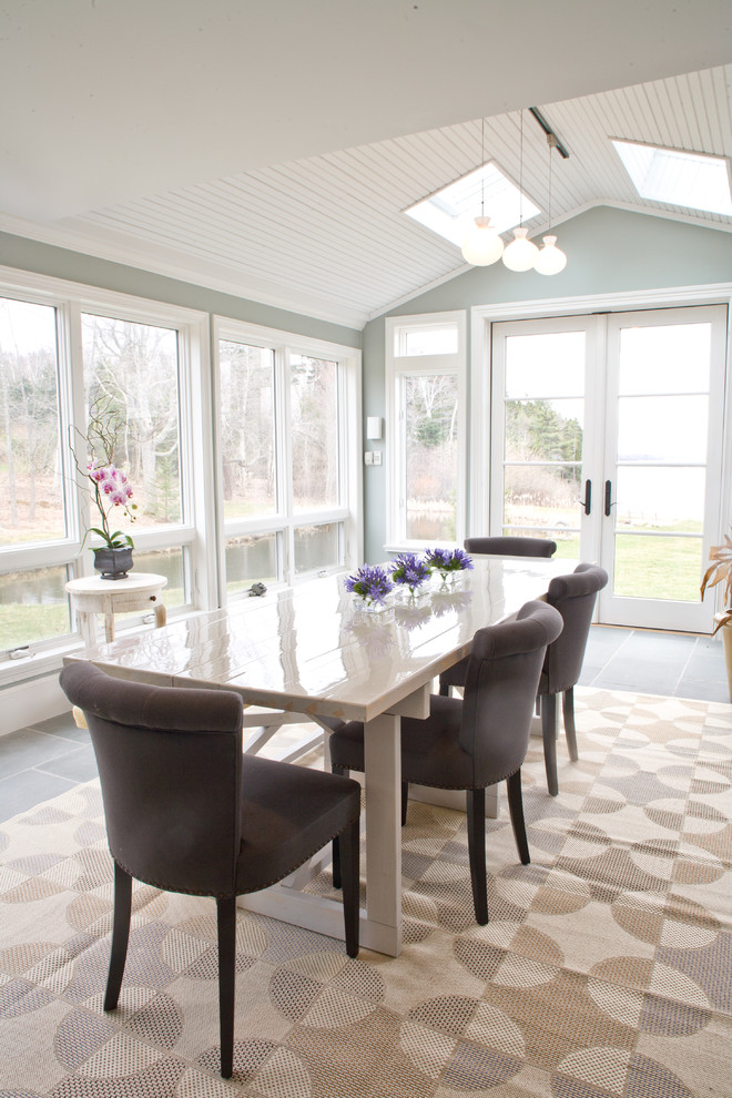 Inspiration for a coastal dining room remodel in Portland Maine with gray walls