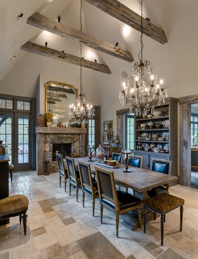 Dining room - french country beige floor dining room idea in Other with white walls, a standard fireplace and a stone fireplace