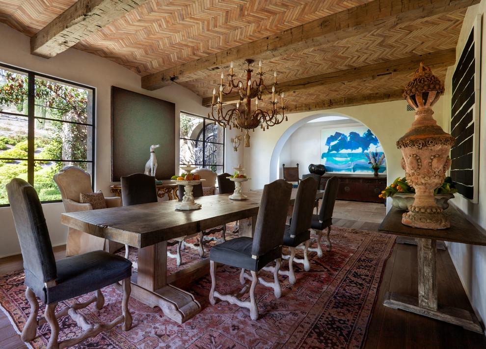 Enclosed dining room - mediterranean dark wood floor enclosed dining room idea in Los Angeles with beige walls