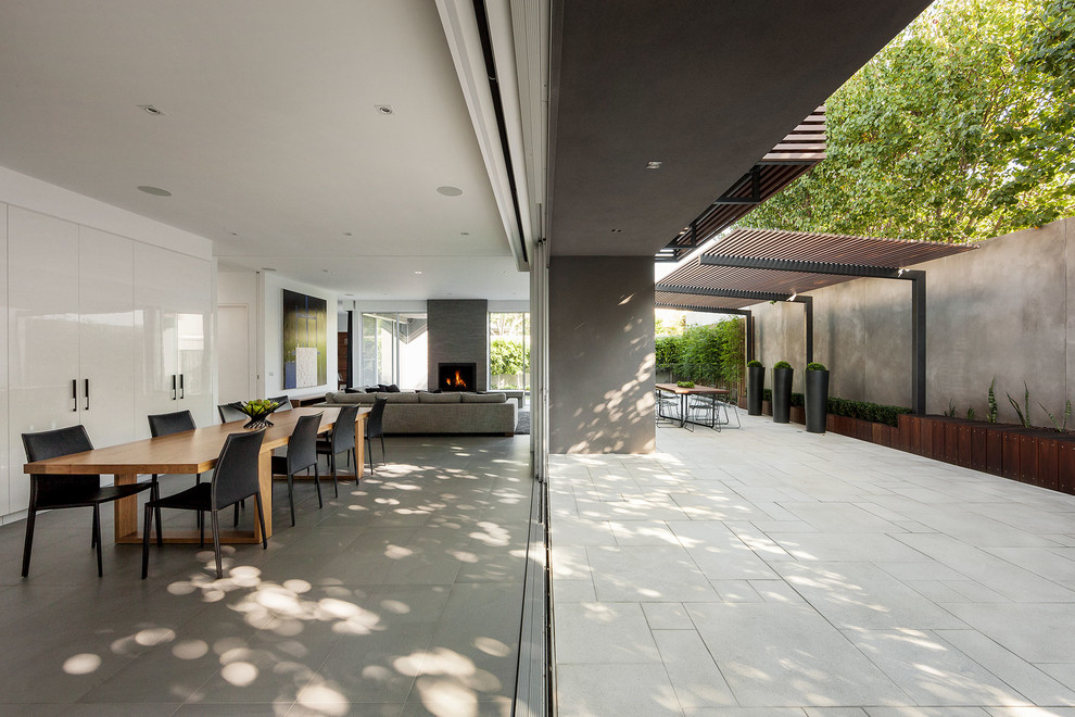 Photo of a contemporary dining room in Melbourne with white walls.