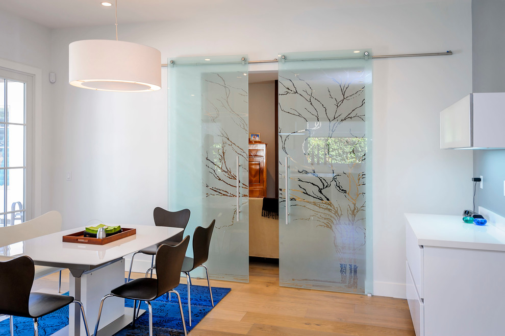 Example of a trendy dining room design in San Francisco with white walls