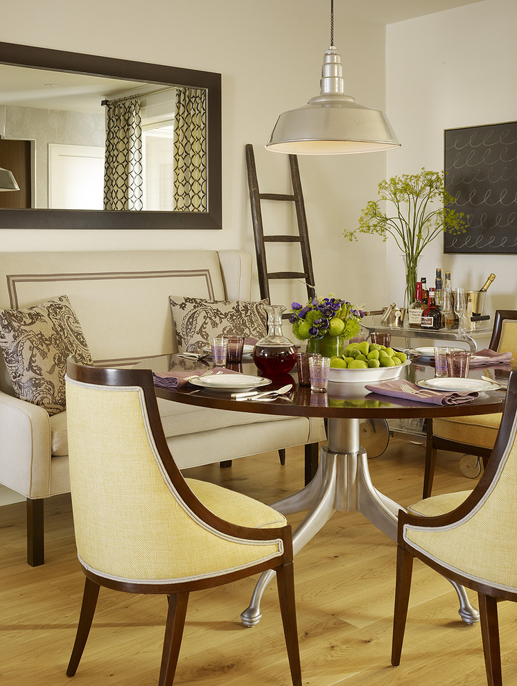 Example of a transitional medium tone wood floor dining room design in San Francisco with white walls