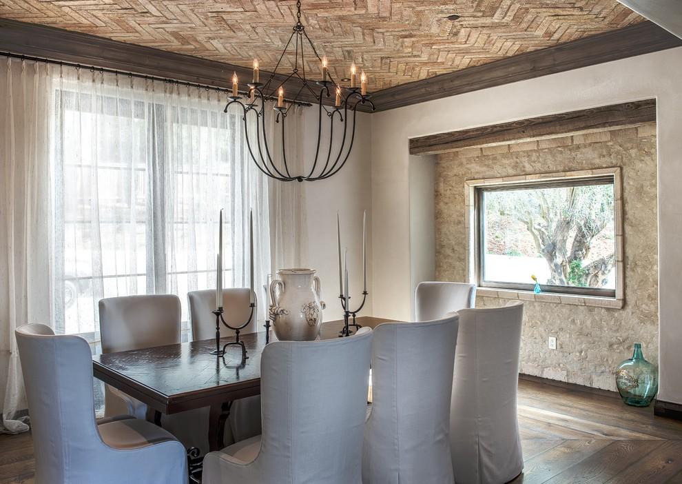 Enclosed dining room - mediterranean dark wood floor enclosed dining room idea in San Francisco with beige walls
