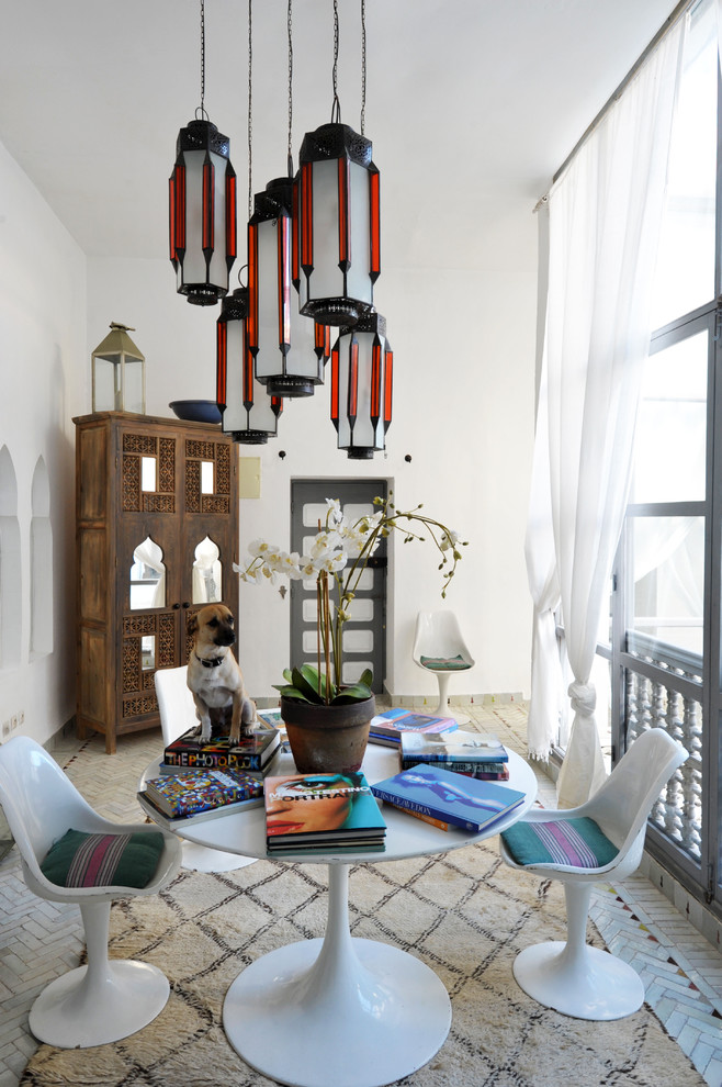 Inspiration for an eclectic dining room remodel in New York with white walls