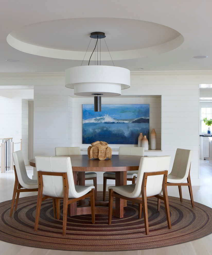 Mid-sized beach style light wood floor and beige floor dining room photo in Boston with white walls and no fireplace
