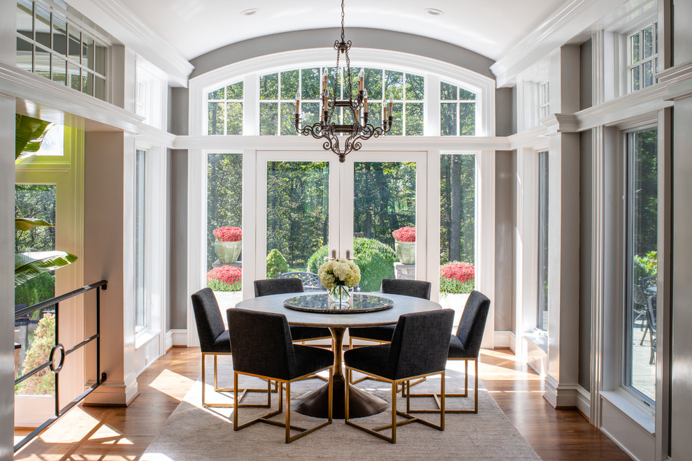 Dining room - large transitional medium tone wood floor and brown floor dining room idea in DC Metro with gray walls