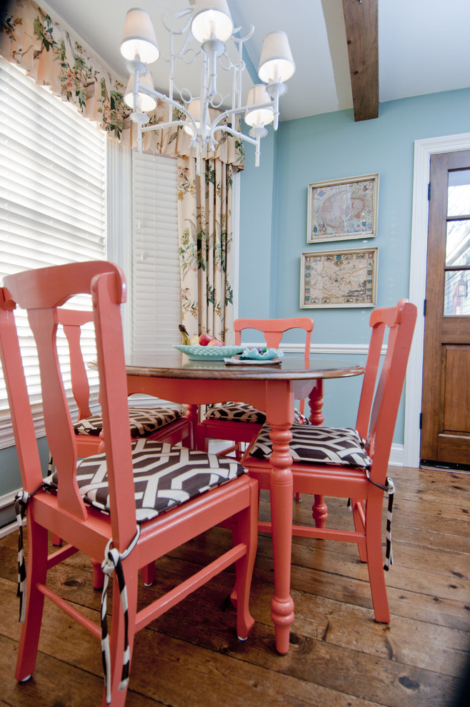Dining room - eclectic dark wood floor dining room idea in Milwaukee with blue walls