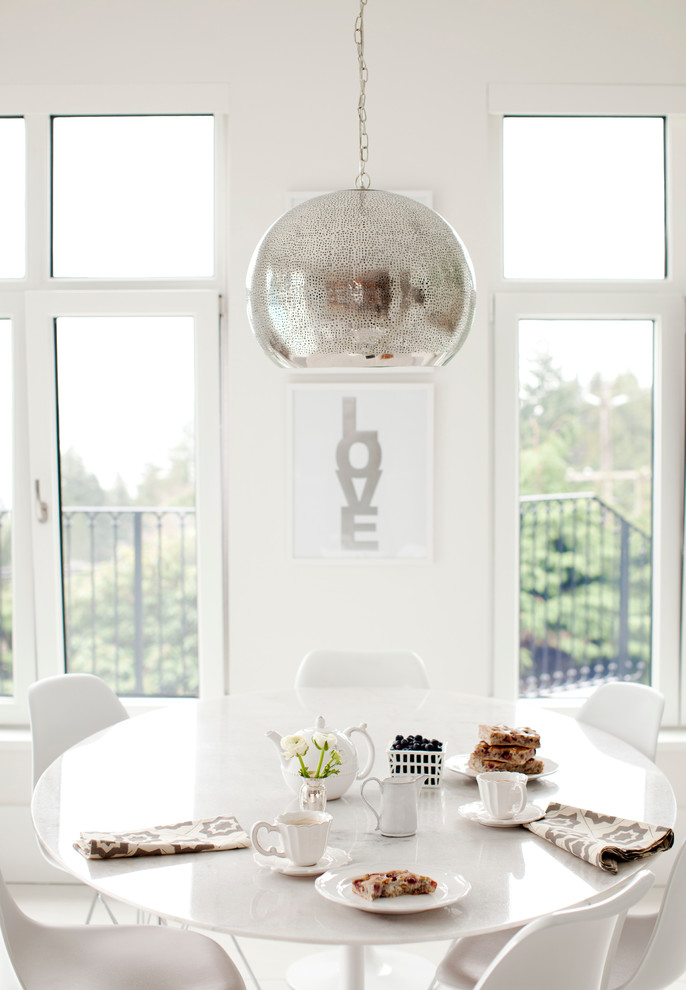 Example of a trendy dining room design in Vancouver with white walls