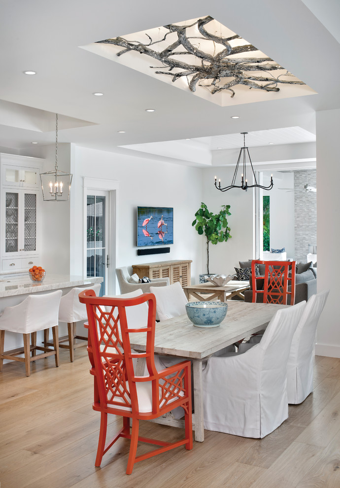 Great room - coastal light wood floor great room idea in Miami with white walls