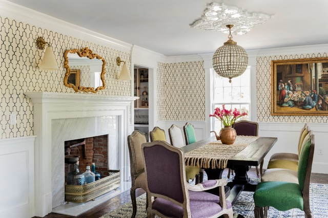 Inspiration for a large timeless dark wood floor enclosed dining room remodel in Boston with multicolored walls, a standard fireplace and a stone fireplace