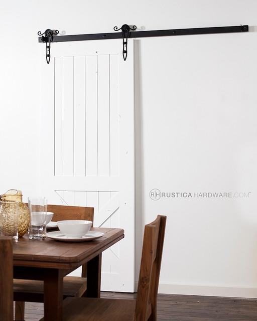 Rod iron scroll barn door hardware mediterranean for Barn door dining room