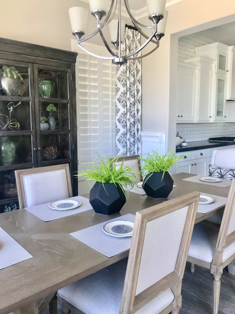 Example of a mid-sized transitional porcelain tile and gray floor kitchen/dining room combo design in Phoenix with gray walls