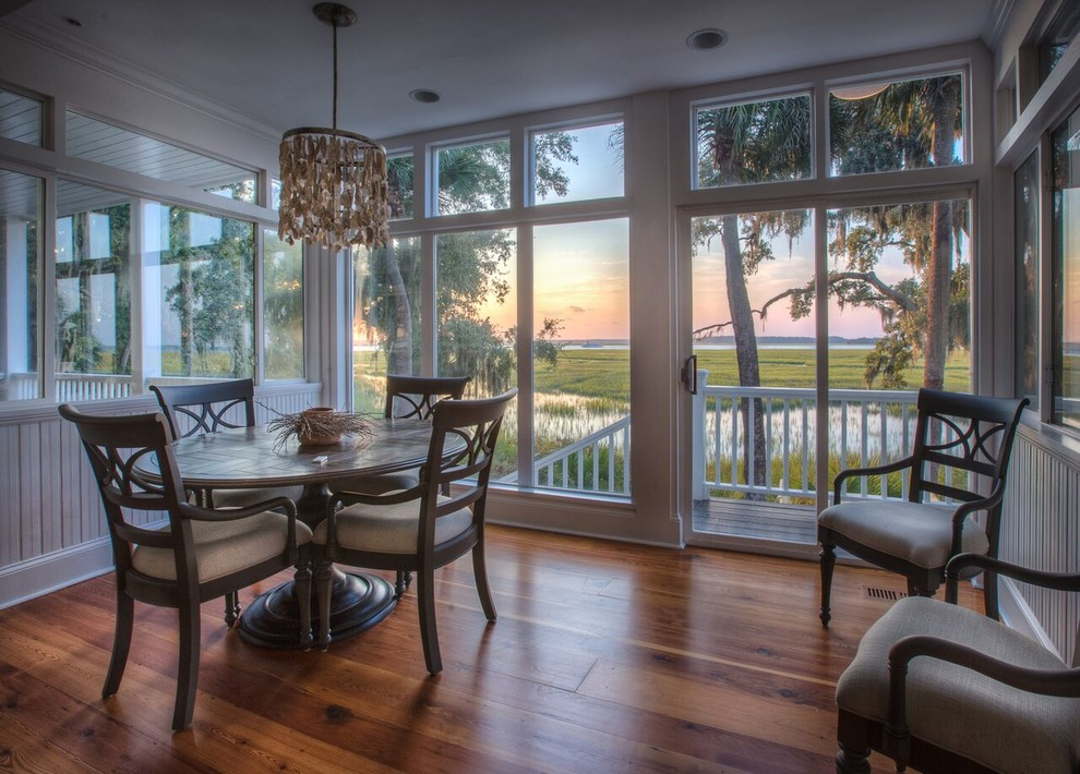 Inspiration for a mid-sized coastal medium tone wood floor and brown floor kitchen/dining room combo remodel in Atlanta with white walls and no fireplace