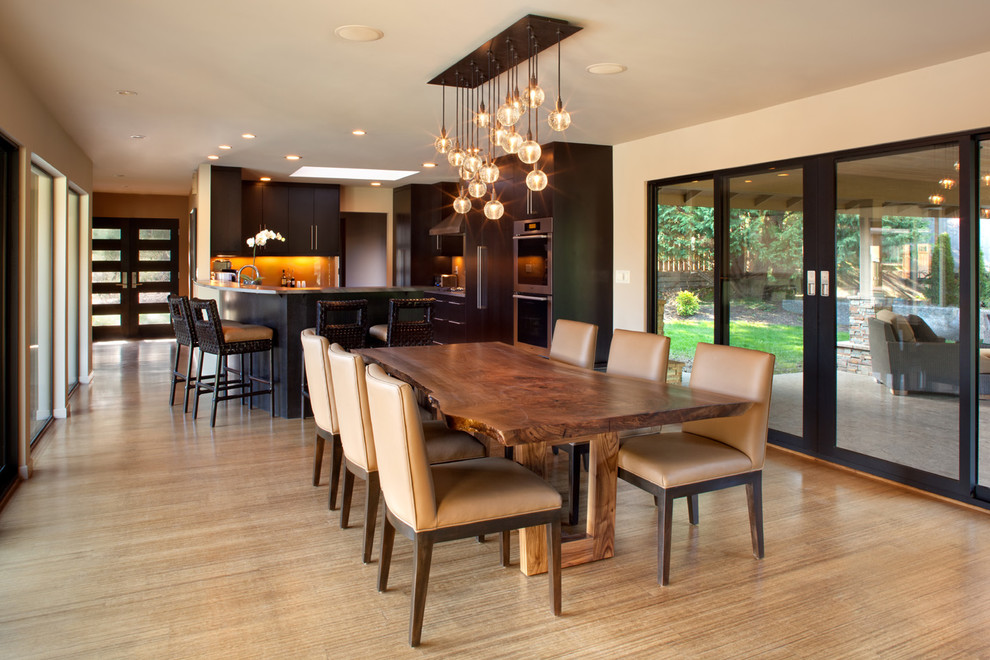 Inspiration for a contemporary light wood floor kitchen/dining room combo remodel in Portland with beige walls