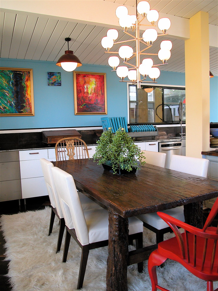 Inspiration for a contemporary dining room remodel in San Francisco with blue walls
