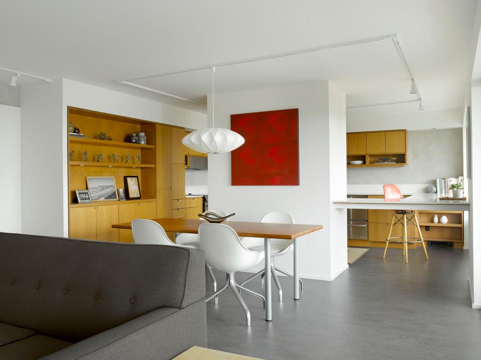 Dining room - 1960s concrete floor dining room idea in Seattle
