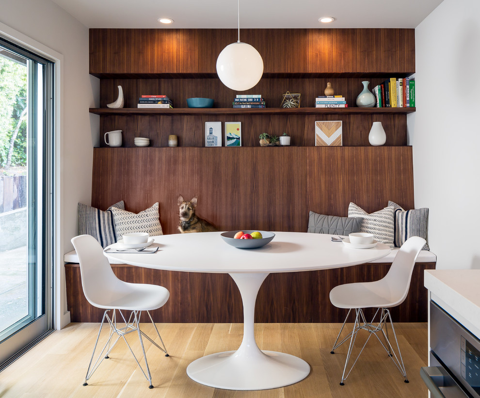Kitchen/dining room combo - mid-century modern light wood floor and beige floor kitchen/dining room combo idea in San Francisco with white walls
