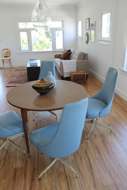 mid century modern chairs in blue modern dining room los angeles