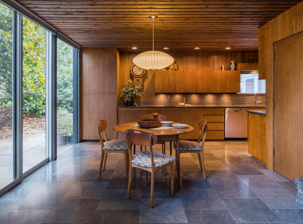 Large 1960s ceramic tile, gray floor, wood ceiling and wood wall kitchen/dining room combo photo in Portland