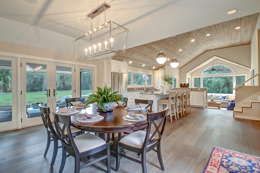 Mid-sized transitional medium tone wood floor and brown floor kitchen/dining room combo photo in Jacksonville with gray walls and no fireplace