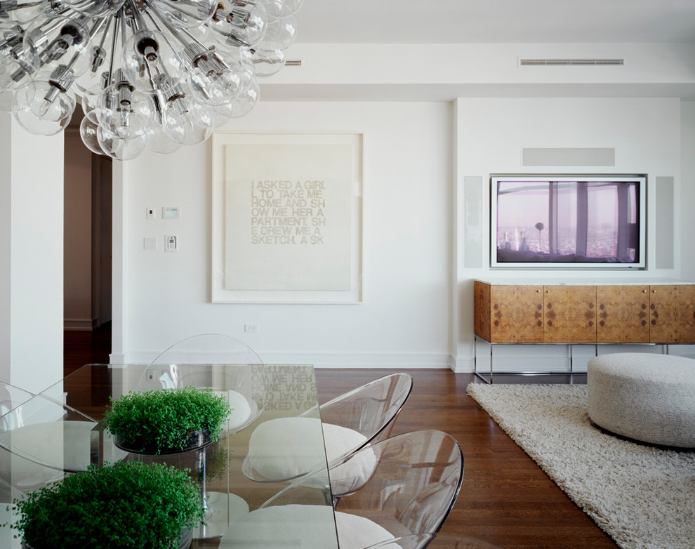 Photo of a contemporary open plan dining in New York with white walls, medium hardwood floors and no fireplace.