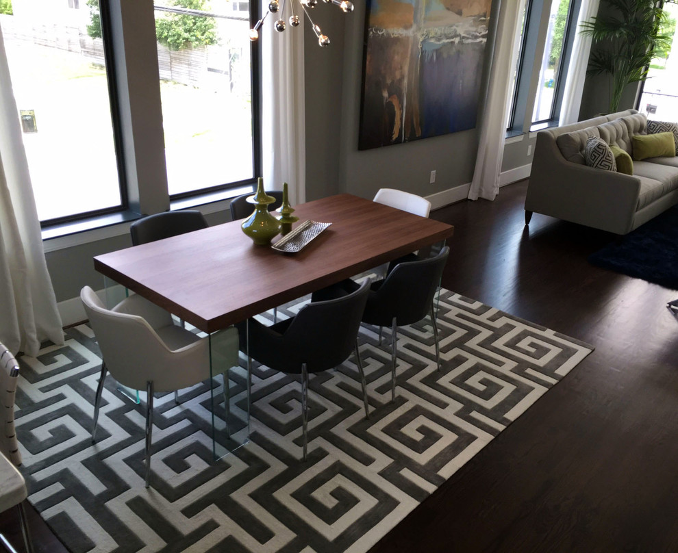 Dining room - small modern dark wood floor and brown floor dining room idea in Houston with gray walls, a standard fireplace and a metal fireplace