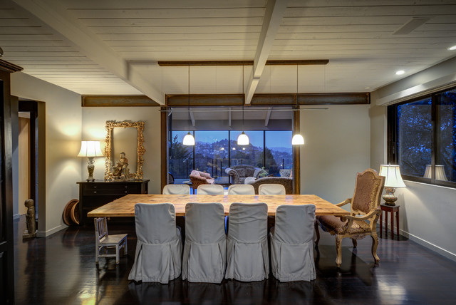 Inspiration for a mid-sized eclectic dark wood floor dining room remodel in San Francisco with gray walls