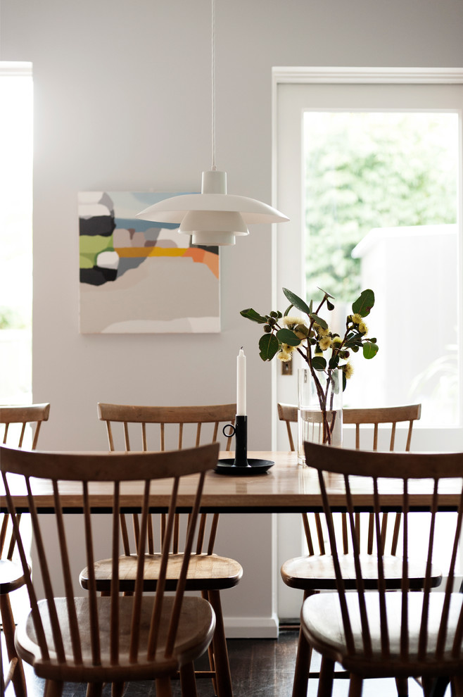 Example of a danish dining room design in Sydney with white walls