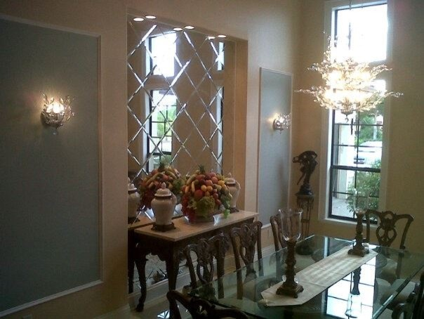 Mirror wall traditional dining room. Mirror wall