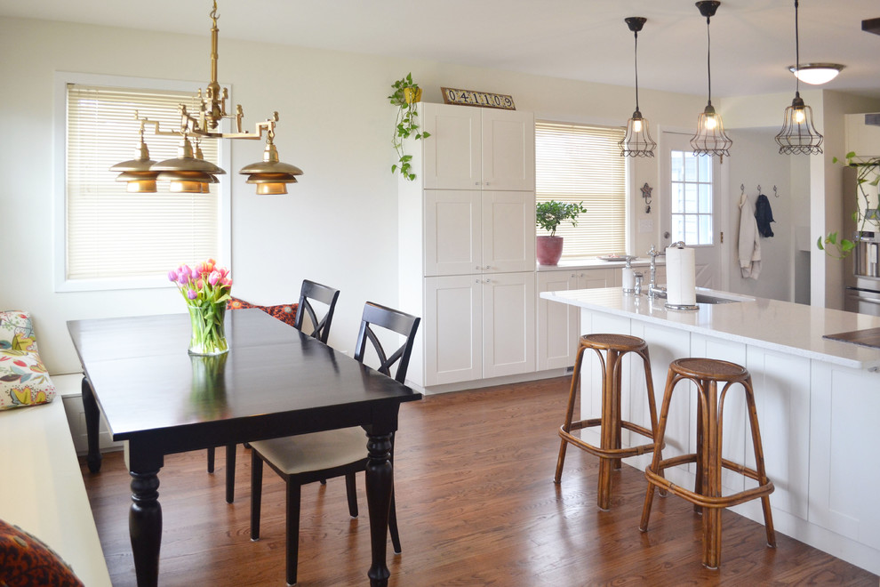 Kitchen/dining room combo - traditional medium tone wood floor kitchen/dining room combo idea in Chicago with white walls