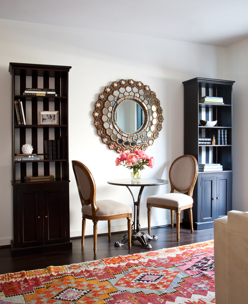 Inspiration for a contemporary dark wood floor dining room remodel in Boise with white walls