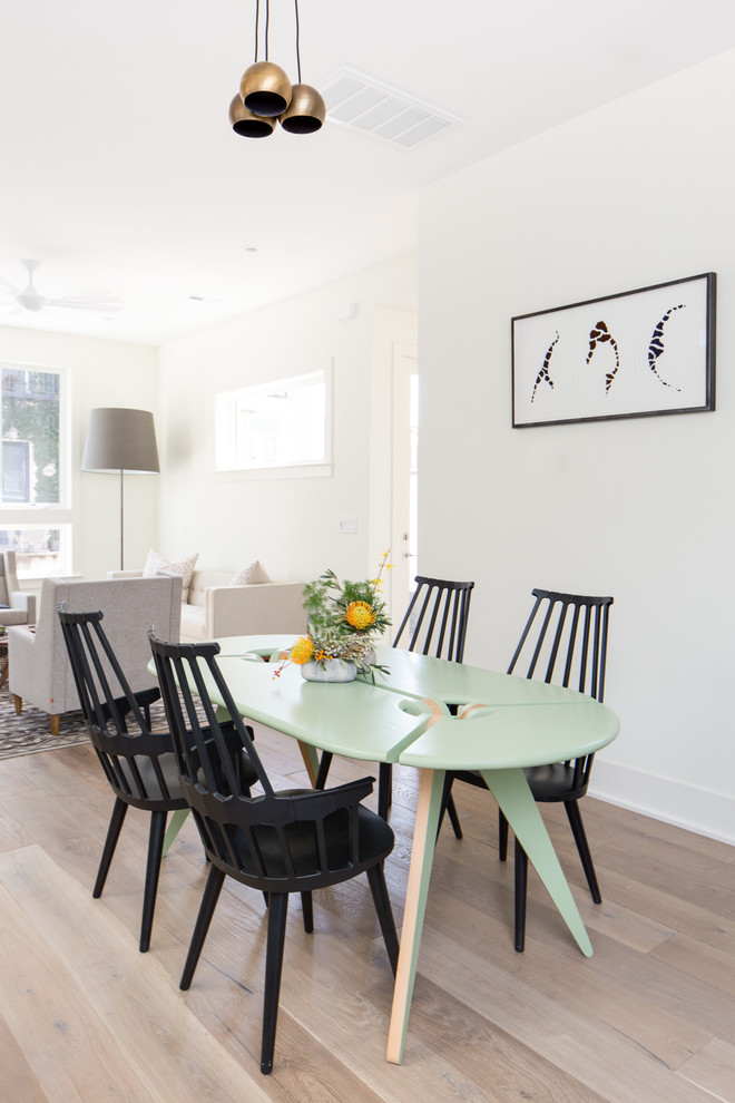 Inspiration for a scandinavian light wood floor dining room remodel in Charleston with white walls