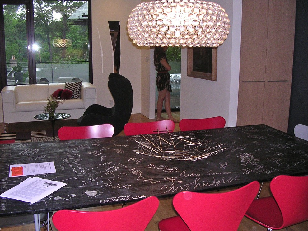 Example of a minimalist dining room design in Other