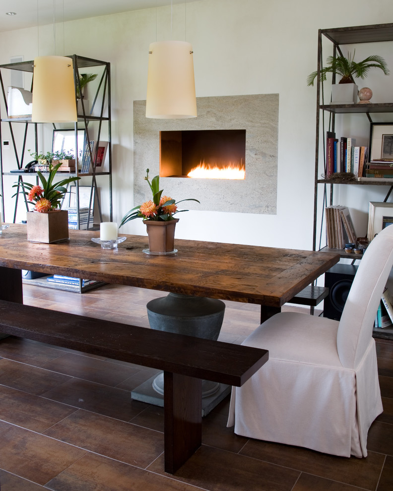 Inspiration for a transitional dining room remodel in New York with white walls and a ribbon fireplace