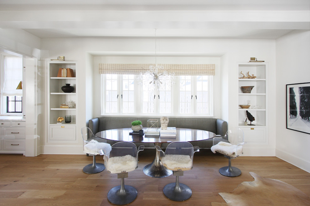 Inspiration for a transitional medium tone wood floor kitchen/dining room combo remodel in Charlotte with white walls