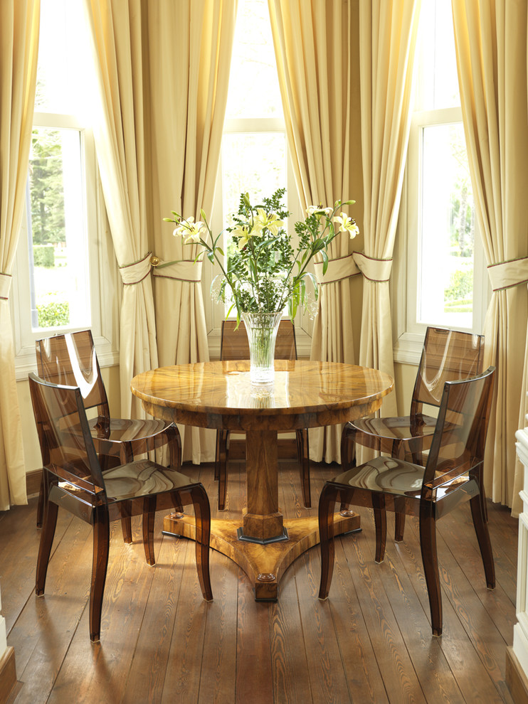 Inspiration for a contemporary dark wood floor dining room remodel in London