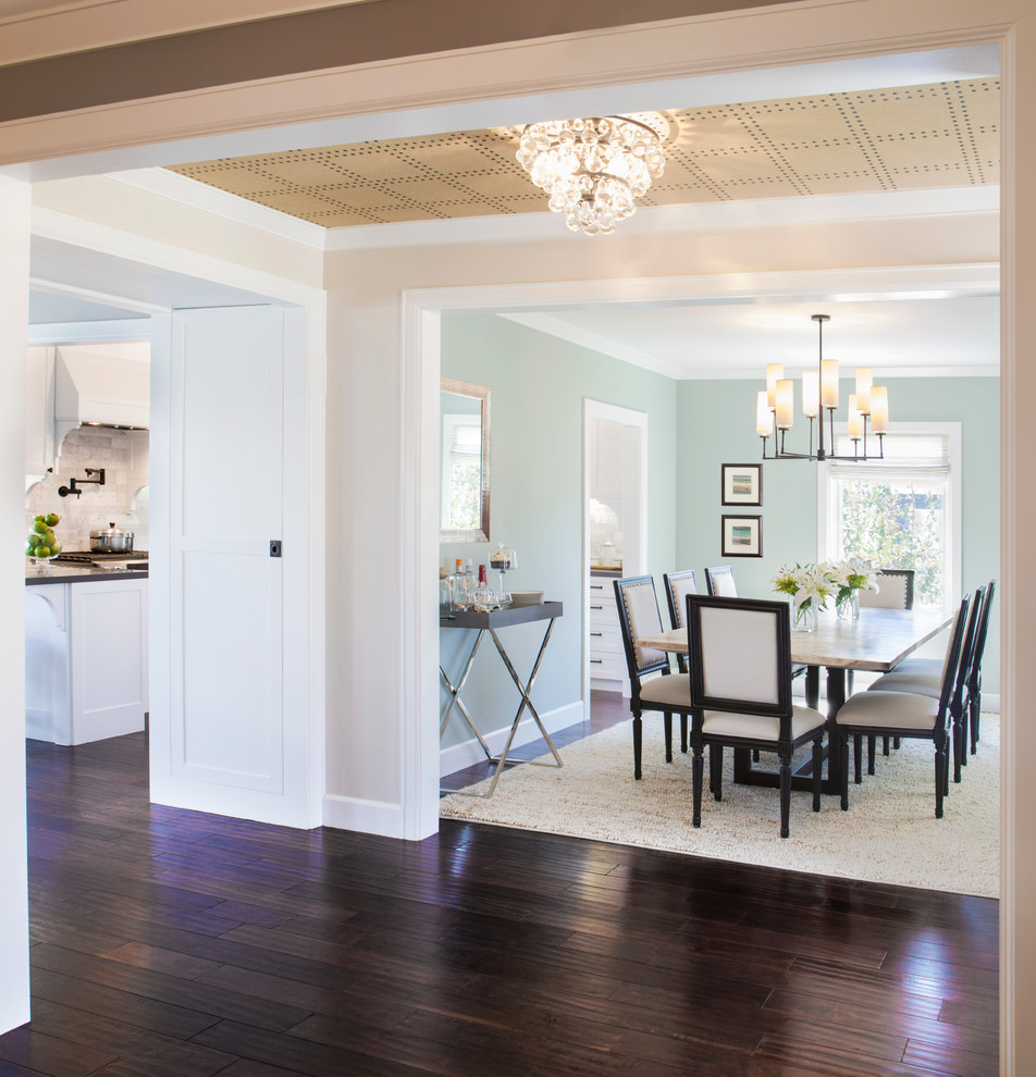 Example of a transitional dark wood floor and brown floor kitchen/dining room combo design in Los Angeles with no fireplace and blue walls