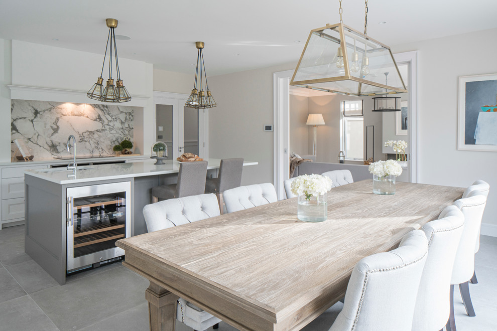 Trendy kitchen/dining room combo photo in Dublin with beige walls and no fireplace