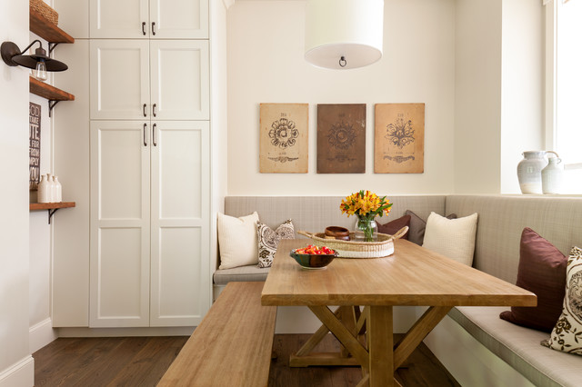Kitchen/dining room combo - mid-sized cottage medium tone wood floor and brown floor kitchen/dining room combo idea in Seattle with white walls and no fireplace