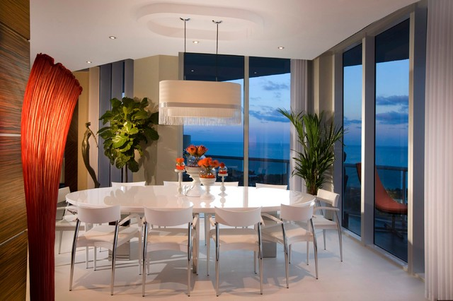 Example Of A Minimalist Dining Room Design In Miami With Beige Walls