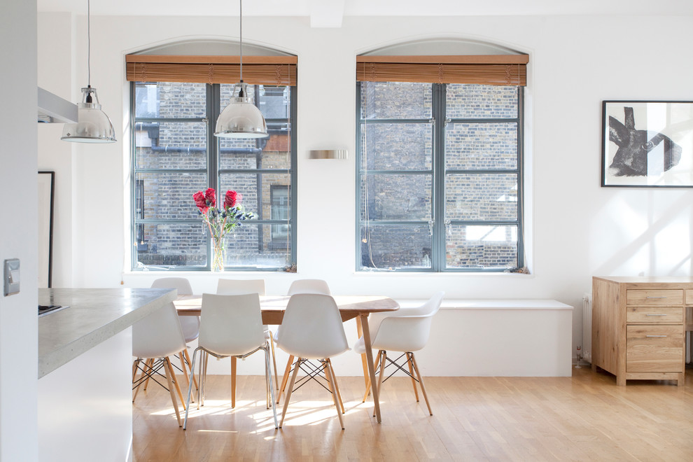 Minimalist dining room photo in London with white walls
