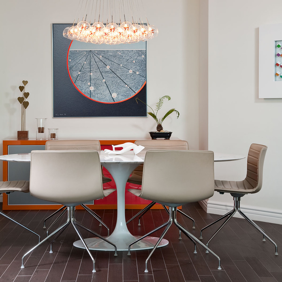 Dining room - modern dining room idea in Las Vegas with white walls