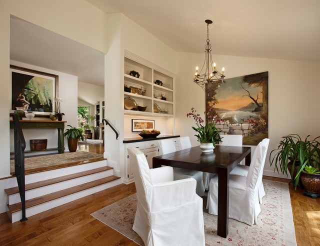 Example Of A Classic Dark Wood Floor Dining Room Design In Santa Barbara  With White Walls