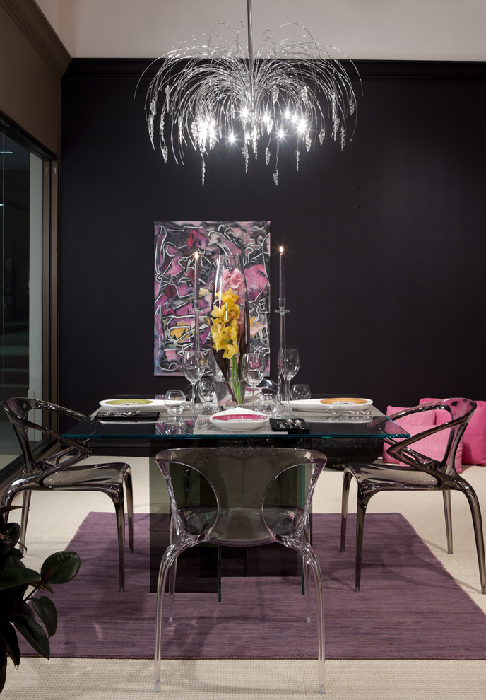 Example of a trendy carpeted dining room design in Detroit with black walls and no fireplace