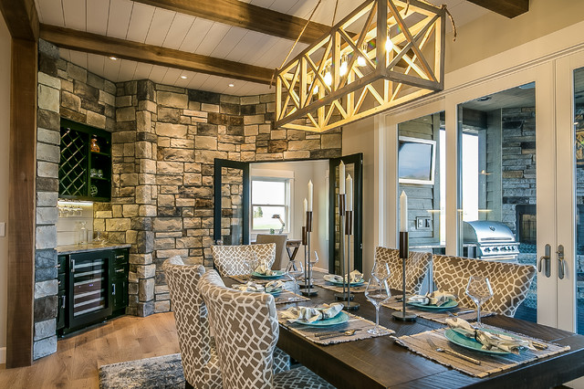 Design ideas for a mid-sized country separate dining room in Other with grey walls, light hardwood floors, no fireplace and beige floor.