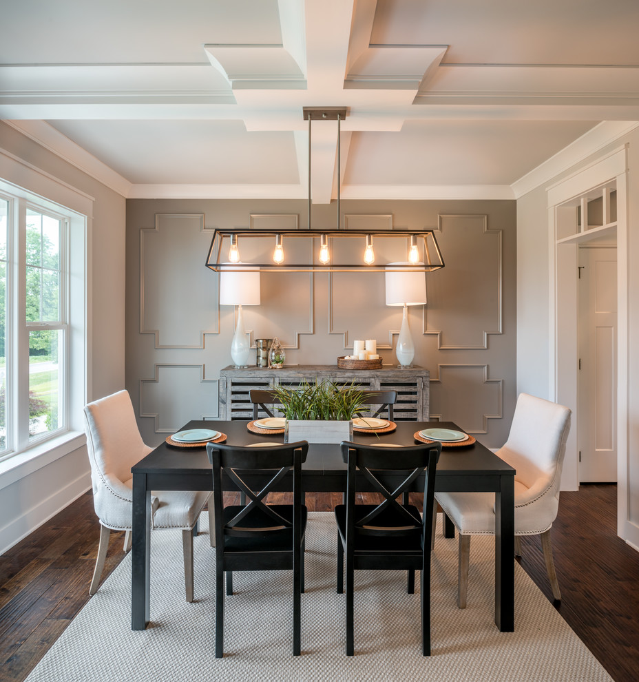 Inspiration for a cottage dark wood floor and brown floor enclosed dining room remodel in Philadelphia with white walls