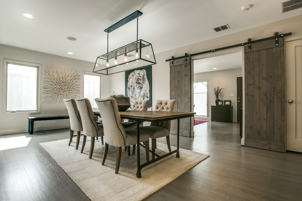 Enclosed dining room - farmhouse dark wood floor enclosed dining room idea in Dallas with gray walls and no fireplace